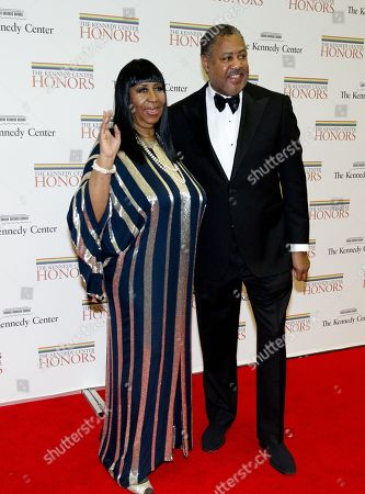 Aretha Franklin and Richard Gibbs arrive for the formal Artist's Dinner honoring the recipients of the 2012 Kennedy Center Honors hosted by United States Secretary of State Hillary Rodham Clinton at the U.S. Department of State.