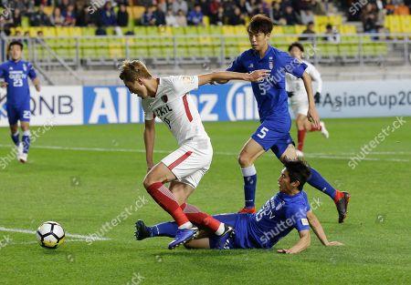 Yuma Suzuki, Jag Ho-ik. Japanese Kashima Antlers' Yuma Suzuki, left, is tackled by South Korean Suwon Samsung Bluewings' Jag Ho-ik during the second-leg semifinal of the Asian Champions League at Suwon World Cup Stadium in Suwon, South Korea