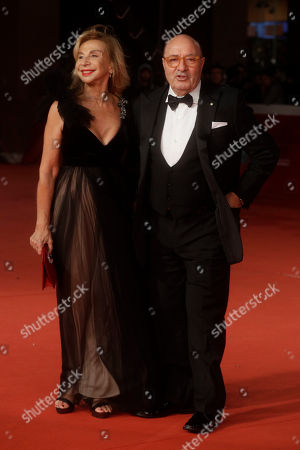 Art Directors and Costume designers Dante Ferretti, right, poses with Francesca Lo Schiavo as they arrive on the red carpet at the 13th edition of the Rome Film Fest, in Rome