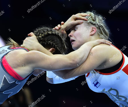 Petra Maarit Olli (white) of Finland wins against Danielle Suzanne Lappage of Canada in the final of women's 65kg category of the Wrestling World Championships in Budapest, Hungary, 24 October 2018.