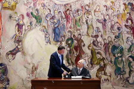 Wolfgang Schaeuble, Yuli Edelstein. Bundestag President Wolfgang Schaeuble, right, shakes hands with Israeli Knesset Speaker Yuli Edelstein after signing the guestbook, during his visit to the Knesset, the Israeli parliament, in Jerusalem
