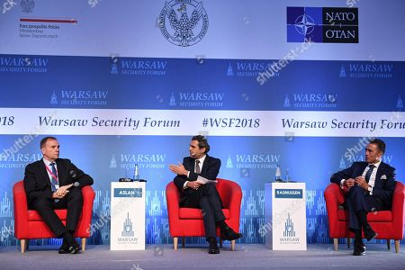 Gen. Frederick Ben Hodges (L), Former NATO Secretary General Anders Fogh Rasmussen (R) and journalist of Deutsche Welle Ali Aslan (C) sit together during the first day of the Warsaw Security Forum 2018 in Warsaw, Poland, 24 October 2018. The forum is organized by the Casimir Pulaski Foundation in cooperation with the National Security Bureau.