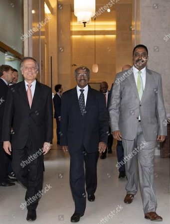 Italian Minister of Foreign Affairs and International Cooperation, Enzo Moavero Milanesi (L), walks together with Ethiopian counterpart Workneh Gebeyehu (R) and Eritrean counterpart Osman Mohammed Saleh (C), prior to a business lunch within the Italy Africa Conference, at the Farnesina Palace in Rome, Italy, 24 October 2018.
