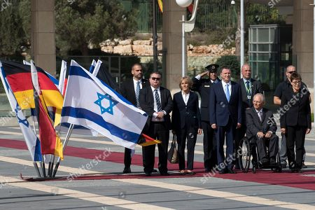 Germany's Chairman of the Bundestag Wolfgang Schaeuble sits in his wheelchair (R) as he is welcomed to the Knesset (Parliament) in Jerusalem by Knesset Speaker Yuli Edelstein (4-R) at the Knesset in Jerusalem, 24 October 2018.