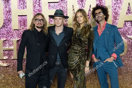 Stock Picture of Justin Hawkins, Rufus Taylor, Frankie Poullain, Jessica Clarke. Justin Hawkins, Rufus Taylor and Frankie Poullain of the Darkness along with model Jessica Clarke pose for photographers upon arrival at the world premiere of the film 'Bohemian Rhapsody' in London