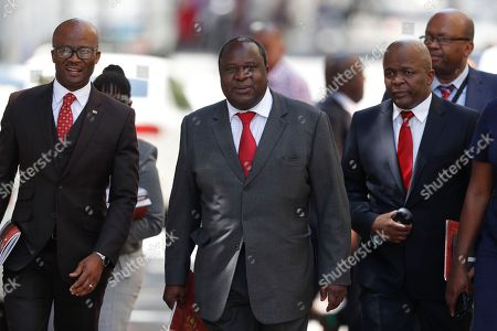 South African newly-appointed Finance Minister Tito Mboweni (C) arrives to deliver the mid-term budget statement at parliament, Cape Town, South Africa, 24 October 2018. South African President Cyril Ramaphosa appointed Mboweni two weeks ago following Nhlanhla Nene's resignation.