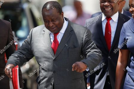 South African newly appointed Finance Minister Tito Mboweni (C) gestures as he arrives to deliver the mid-term budget statement at parliament, Cape Town, South Africa, 24 October 2018. South African President Cyril Ramaphosa appointed Mboweni two weeks ago following Nhlanhla Nene's resignation.