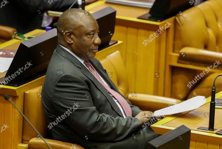 South African President Cyril Ramaphosa listens to newly appointed Finance Minister Tito Mboweni (not pictured) delivering the mid-term budget statement in Parliament, Cape Town, South Africa 24 October 2018. South African president Cyril Ramaphosa appointed Mboweni two weeks ago following Nhlanhla Nene's resignation.