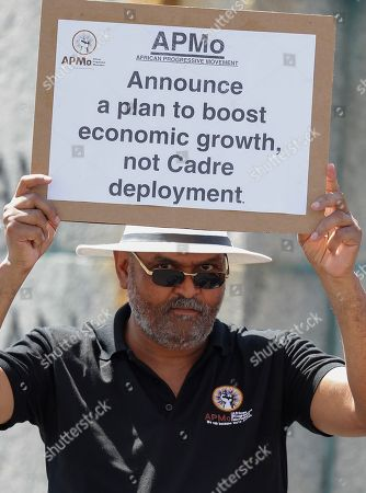 A member of the African Progessive Movement protests outside parliament during the speech of newly appointed Finance Minister Tito Mboweni as he delivered the mid-term budget statement in Parliament, Cape Town, South Africa, 24 October 2018. South African president Cyril Ramaphosa appointed Mboweni two weeks ago following Nhlanhla Nene's resignation.