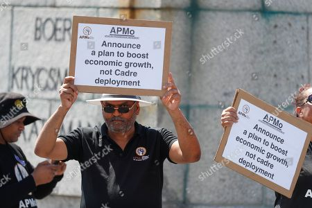 Stock Photo of Members of the African Progessive Movement protest outside parliament during the speech of newly appointed Finance Minister Tito Mboweni as he delivered the mid-term budget statement in Parliament, Cape Town, South Africa, 24 October 2018. South African president Cyril Ramaphosa appointed Mboweni two weeks ago following Nhlanhla Nene's resignation.