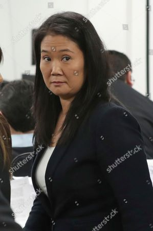 Keiko Fujimori, the daughter of Peru's former President Alberto Fujimori, and leader of the opposition party, attends a hearing where prosecutors are asking for 36 months of preventive detention for the alleged crime of money laundering, in Lima, Peru, . She remains under investigation over some $1.2 million in undeclared financial contributions to her 2011 presidential campaign that were allegedly made by Odebrecht, the Brazilian construction firm at the heart of Latin America's largest-ever graft scandal