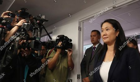Keiko Fujimori, the daughter of Peru's former President Alberto Fujimori, and leader of the opposition party, enters the courtroom to attend a hearing where prosecutors are asking for 36 months of preventive detention for the alleged crime of money laundering, in Lima, Peru, . She remains under investigation over some $1.2 million in undeclared financial contributions to her 2011 presidential campaign that were allegedly made by Odebrecht, the Brazilian construction firm at the heart of Latin America's largest-ever graft scandal