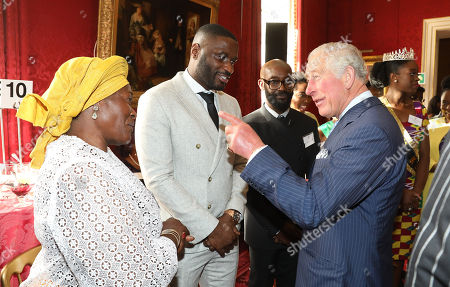 Prince Charles talking with musician Lethal Bizzle (c) and Dilys Thompson (l) at a reception to mark their upcoming tour to Gambia, Ghana and Nigeria at St James Palace