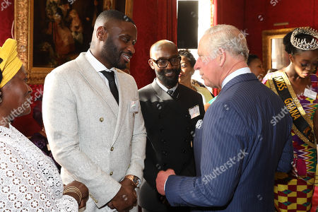 Prince Charles talking with musician Lethal Bizzle (l) at a reception to mark their upcoming tour to Gambia, Ghana and Nigeria at St James Palace