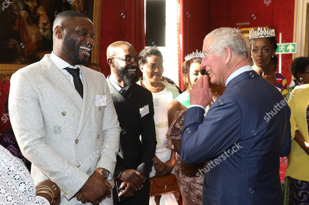 Stock Picture of Prince Charles talking with musician Lethal Bizzle (l) at a reception to mark their upcoming tour to Gambia, Ghana and Nigeria at St James Palace