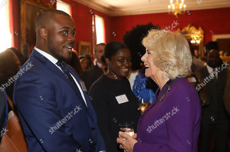 Camilla Duchess of Cornwall talking with The Great British Bake Off contestant Selasi Gbormittah (l) at a reception to mark their upcoming tour to Gambia, Ghana and Nigeria at St James Palace