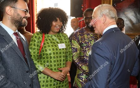 Prince Charles talking the winner of The Voice in 2018, Ruti Olajugbagbe at a reception to mark their upcoming tour to Gambia, Ghana and Nigeria at St James Palace