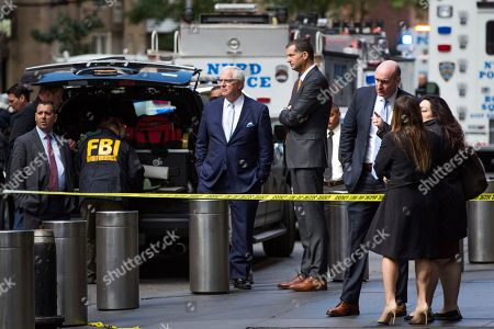 NYPD Deputy Commissioner of Intelligence & Counterterrorism John Miller, center, arrives outside Time Warner Center, in New York. Law enforcement officials say a suspicious package that prompted an evacuation of CNN's offices is believed to contain a pipe bomb
