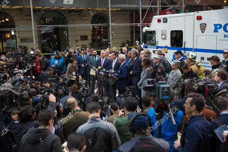 NYPD Deputy Commissioner of Intelligence & Counterterrorism John Miller delivers remarks during a press conference after NYPD personnel removed an explosive device from Time Warner Center, in New York. Other packages were sent to the offices of Gov. Andrew Cuomo and to the home of President Bill Clinton