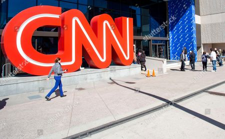 People walk outside CNN Center, in Atlanta. CNN is now screening all people who enter after a suspicious package was delivered to CNN in New York. NYPD's chief of counterterrorism says the explosive device sent to CNN's headquarters in New York appeared to be sent by the same person who mailed pipe bombs to George Soros, Hillary Clinton and former President Barack Obama