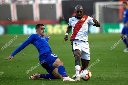 Atheltic Club's Dani Garcia (L) in action against Rayo Vallecano's Gael Kakuta (R) during the Spanish La Liga soccer match between Rayo Vallecano and Athletic Bilbao at the Vallecas stadium in Madrid, Spain, 24 October 2018.