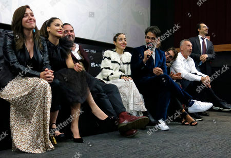 Actors Mariana Trevino, from left to right, Ana Claudia Talancon, producer Miguel Mier, actors Cecilia Suarez and Miguel Rodarte participate in the presentation of their Mexican film Perfectos Desconocidos at the Morelia Film Festival in Morelia, Mexico, . Actor Bruno Bichir is pictured far right