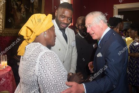 Prince Charles meets with Lethal Bizzle (R) at a reception at St James's Palace
