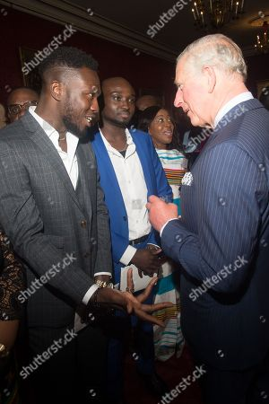 Stock Photo of Prince Charles meets with X-Factor contestants Reggie Zippy 'n' Bollie at a reception at St James's Palace