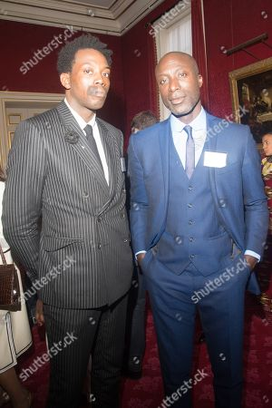 Fashion designers Adrien Sauvage and Ozwald Boateng ata reception hosted by Prince Charles and Camilla Duchess of Cornwall at St James's Palace