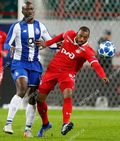 Lokomotiv's Manuel Fernandes, right, and Porto Danilo challenge for the ball during the Group D Champions League soccer match between Lokomotiv Moscow and FC Porto at the Lokomotiv Stadium in Moscow, Russia