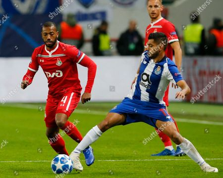 Lokomotiv's Manuel Fernandes, left, and Porto Jesus Corona challenge for the ball during the Group D Champions League soccer match between Lokomotiv Moscow and FC Porto at the Lokomotiv Stadium in Moscow, Russia