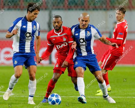 Porto Oliver Torres, Lokomotiv's Manuel Fernandes, Porto Maxi Pereira, Lokomotiv's Anton Miranchuk, from left to right, challenge for the ball during the Group D Champions League soccer match between Lokomotiv Moscow and FC Porto at the Lokomotiv Stadium in Moscow, Russia