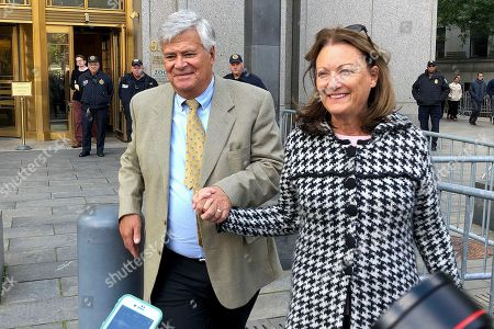 Former New York state Senate leader Dean Skelos, left, leaves court with his wife, Gail, in New York. Skelos was sentenced to four years and three months in prison after his conviction on public corruption charges. U.S. District Judge Kimba M. Wood announced the penalty for the longtime Republican powerbroker, citing his health challenges at age 70 as reason to reduce his sentence from the five years she gave him at a previous sentencing