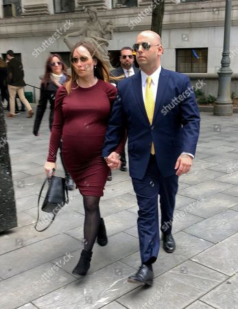 Adam Skelos, right, son of former New York state Senate leader Dean Skelos, arrives at court for sentencing, with his fiancé, in New York. Adam Skelos was convicted in July on charges of extortion, wire fraud and bribery