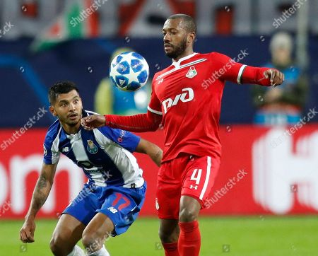 Porto forward Jesus Corona, left, and Lokomotiv's midfielder Manuel Fernandes challenge for the ball during a Group D Champions League soccer match between Lokomotiv Moscow and FC Porto at the Lokomotiv Stadium in Moscow, Russia