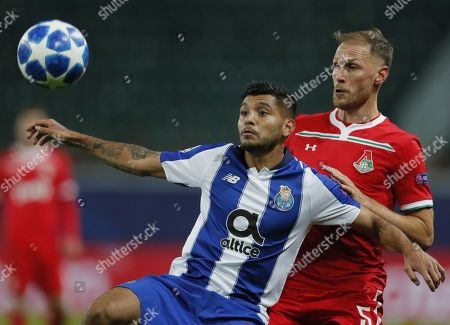 Benedikt Howedes (R) of FC Lokomotiv Moscow in action against Jesus Crona (L) of FC Porto during the UEFA Champions League Group D soccer match between Lokomotiv Moscow and Porto at the Lokomotiv stadium in Moscow, Russia, 24 October 2018.
