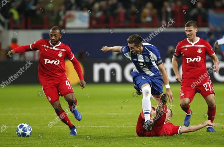 Manuel Fernandes, Jefferson Farfan (2nd-R) and Igor Denisov (R) of FC Lokomotiv Moscow in action against Hector Herrera (C) of FC Porto during the UEFA Champions League Group D soccer match between Lokomotiv Moscow and Porto at the Lokomotiv stadium in Moscow, Russia, 24 October 2018.