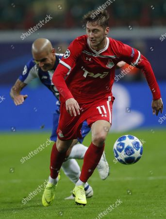 Anton Miranchuk (front) of FC Lokomotiv Moscow in action against Maxi Pereira (beck) of FC Porto during the UEFA Champions League Group D soccer match between Lokomotiv Moscow and Porto at the Lokomotiv stadium in Moscow, Russia, 24 October 2018.
