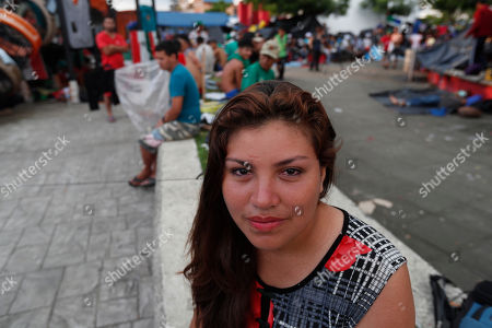 Honduran migrant Alba Rosa Chinchilla Ortiz poses for photos at a temporary shelter in the central park of Huixtla, Mexico, . Chinchilla's husband, an ex-soldier in the Honduran army has survived three attempts to kill him, Chinchilla said. Her partner of six years, he has applied for asylum in the United States and she's trying to join him and their son