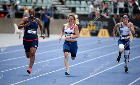Stock Image of Dawn Page, Francesca Rocca, Marion Blot. Dawn Page, left, of the U.S.A., France's Francesca Rocca and Marion Blot of France, right, run in the final of the women's 200m IT7 event during the athletics competition at the Invictus Games in Sydney, . Payne won the gold medal