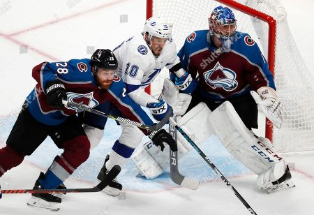 J T Miller, Ian Cole, Semyon Varlamov, ian cole, semyon varlamov, j t miller. Tampa Bay Lightning center J.T. Miller, center, drives between Colorado Avalanche defenseman Ian Cole, left, and goaltender Semyon Varlamov in pursuit of the puck in the first period of an NHL hockey game, in Denver