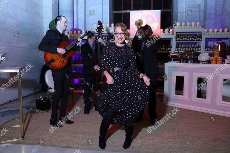 Marcela Valladolid dances alongside a jazz trio at the New Orleans pop-up experience at a launch event of Capital One's Purpose Project on in New York