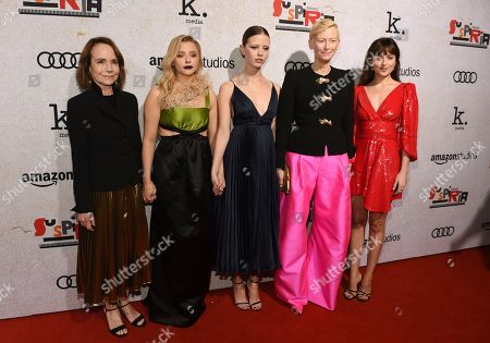 "Jessica Harper, Chlose Grace Moretz, Mia Goth, Tilda Swinton, Dakota Johnson. From left, ""Suspiria"" cast members Jessica Harper, Chloe Grace Moretz, Mia Goth, Tilda Swinton and Dakota Johnson pose together at the premiere of the film at the ArcLight Hollywood, in Los Angeles. Harper was a cast member in the original ""Suspiria"" film in 1977, directed by Dario Argento"