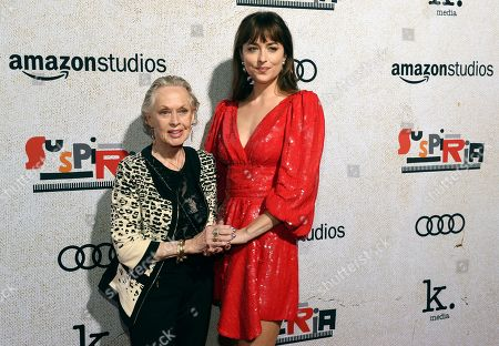 """Stock Photo of Dakota Johnson, Tippi Hedren. Dakota Johnson, right, a cast member in """"Suspiria,"""" poses with her grandmother, actress Tippi Hedren, at the premiere of the film at the ArcLight Hollywood, in Los Angeles"""