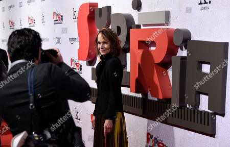"Jessica Harper, a cast member in ""Suspiria,"" poses for a photographer at the premiere of the film at the ArcLight Hollywood, in Los Angeles. Harper also was a cast member in the original 1977 ""Suspiria"" film, directed by Dario Argento"