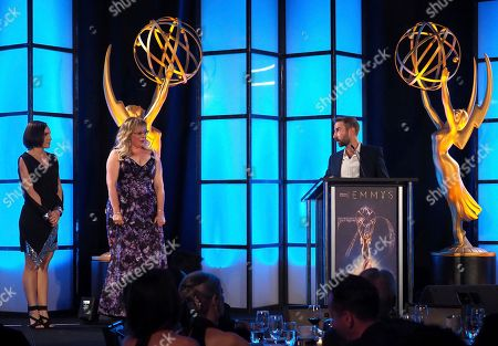 Kirsten Vangsness, Kelvin Lawson. Kirsten Vangsness, left, looks on as Kelvin Lawson, Chief Software Engineer, accepts the Engineering Plaque at the 70th Engineering Emmy Awards on in Los Angeles