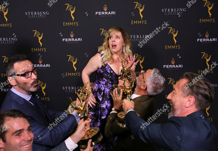 Kirsten Vangsness, center, poses with 2018 Engineering Emmy Award winners at the 70th Engineering Emmy Awards on in Los Angeles