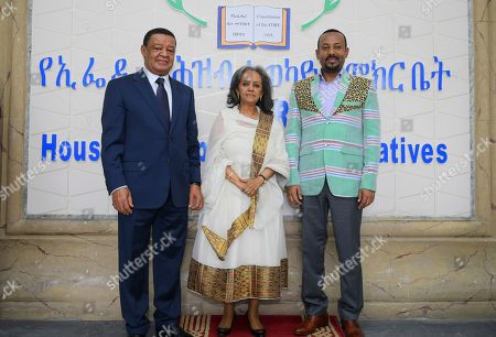 Sahle-Work Zewde (C) poses for photographs with Ethiopia's Prime Minister Abiy Ahmed (R) and her predecessor Mulatu Teshome (L) at the parliament where she was e elected as the president of Ethiopia in Addis Ababa, Ethiopia, 25 October 2018. Sahle-Work, an experienced diplomat and a veteran of the United Nations, became Ethiopia's first female president after the approval by the parliament on 25 October. Her election to the presidency, a ceremonial position in Ethiopia, comes a week after Prime Minister Abiy Ahmed reshuffled his cabinet.