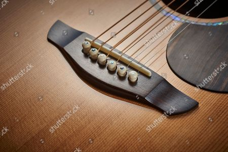 Detail Of The Macassar Ebony Bridge On A Faith Pje Legacy Earth Electro-acoustic Guitar