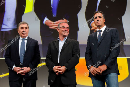 Five-time Tour de France winners Eddy Merckx, from Belgium, left, Bernard Hinault from France, center, and Miguel Indurain from Spain attend the presentation of the 2019 Tour de France cycling race, in Paris, . The 106th edition of the race starts on July 6 2019 to end on the Champs-Elysees avenue on July 28
